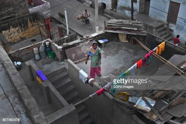 ALWAR RAJASTHAN ALWAR RAJASTHAN INDIA A liberated manual scavenger works at her house terrace located in their locality named 'Harijan Basti'...