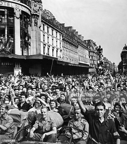 Liberation In Paris France In August 1944 The crowd cheering De Gaulle on rue de Rivoli at the corner of the Hotel de Ville during the liberation
