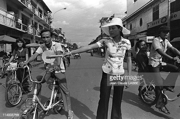 'Liberation' of Ho Chi Minh Vietnam in July 1975Young student regulates the traffic