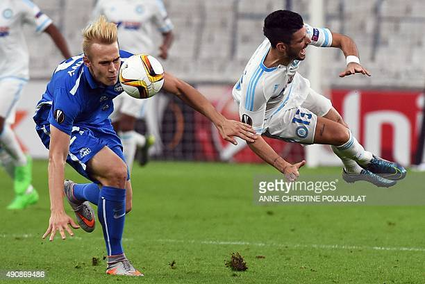 Liberec's defender Lukas Pokorny vies with Marseille's French midfielder Remy Cabella during the UEFA Europa League group F football match between...