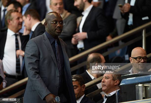 Liberian politician and exfootballer George Weah attends the UEFA Champions league quarterfinal first leg football match PSG vs FC Barcelona at the...