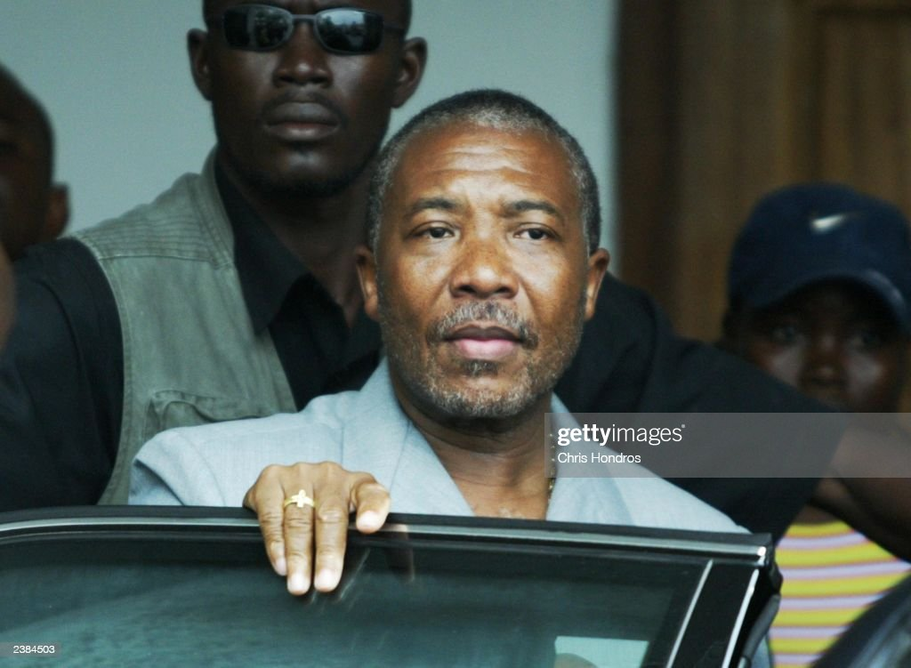 Liberian President Charles Taylor appears after a meeting at his party's headquarters August 9, 2003 in Monrovia, Liberia. His spokesman said that there may be destabilization from the government soldiers and militia who are frequently undisciplined and have not been paid in months after Taylor leaves August 11, 2003.