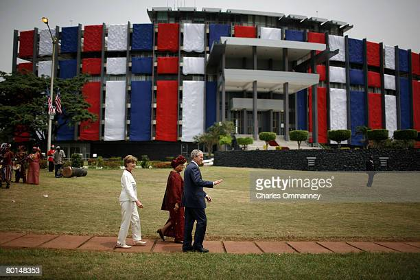 Liberian President Ellen Johnson Sirleaf escorts US President George W Bush and First Lady Laura Bush to lunch after a ceremony at the Executive...