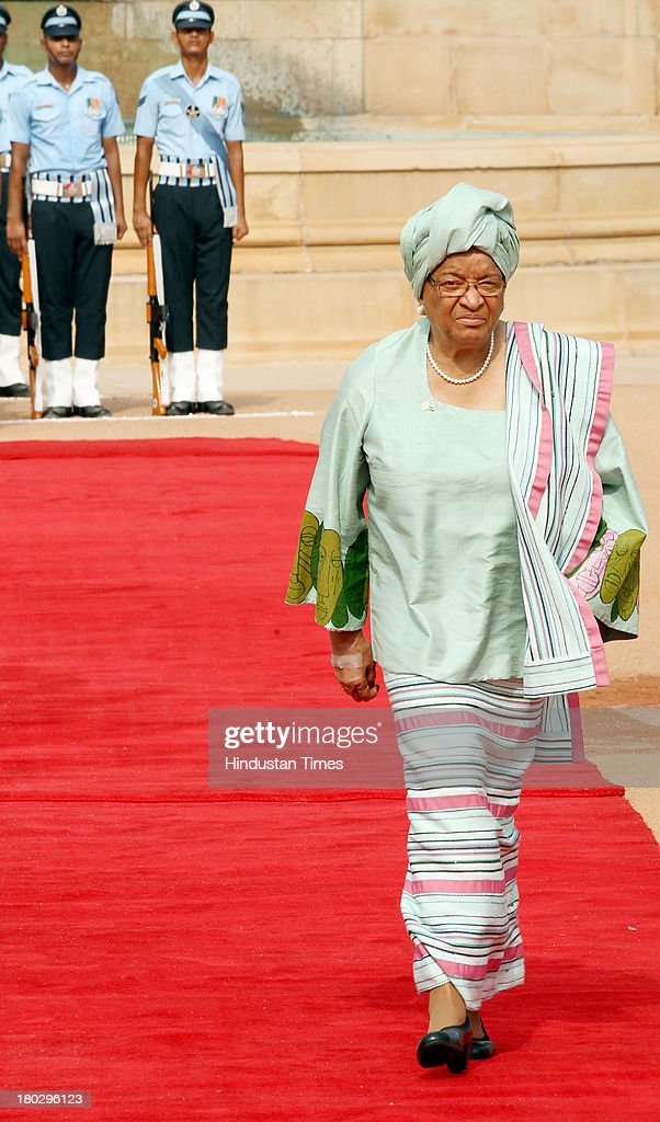 Liberian President Ellen Johnson Sirleaf inspecting the guard of Honour during her ceremonial reception at Rashtrapati Bhawan on September 11, 2013 in New Delhi, India. First African women President Sirleaf is on a five-day state visit to India. India today extended USD 144 million Line of Credit to Liberia to fund a power transmission and distribution project and inked a key energy pact with the West African country.