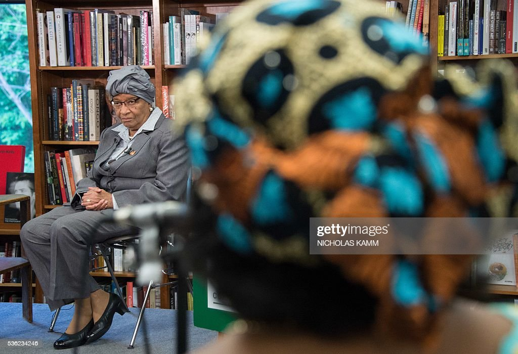 Liberian President Ellen Johnson Sirleaf (L) takes a question from former Malawi president Joyce Banda at the launch of a book about by K. Riva Levinson, president and CEO of KRL International LLC, a Washington communications and government relations firm that serves as the consultancy of record for Liberia, at the Politics and Prose bookstore in Washington, DC, on May 31, 2016. / AFP / NICHOLAS