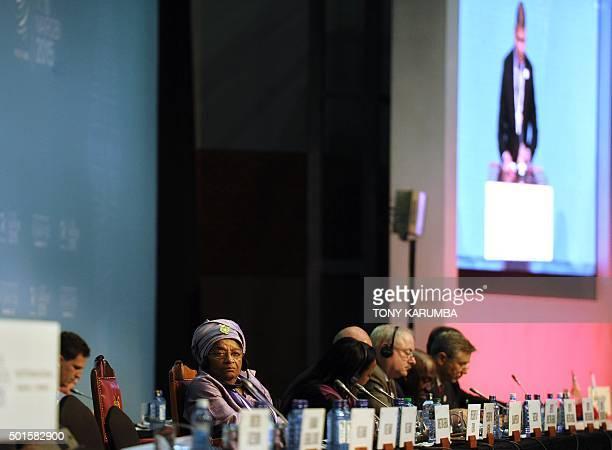 Liberian President Ellen JohnsonSirleaf follows proceedings during Liberia's accession to the World Trade Organisation in Nairobi on December 16 at...