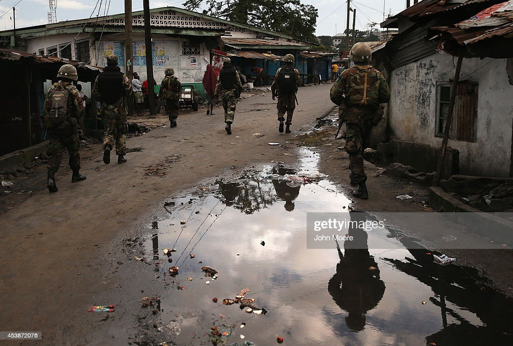 Liberian security forces, part of the country's Ebola Task Force, enforce a quarantine on the West Point slum on August 20, 2014 in Monrovia, Liberia. The quarantine of West Point, a congested favella of 75,000 people, began Wednesday, as the government tries to stop the spread of the virus in the capital city. A mob overran and closed an Ebola isolation ward there on August 16. The Ebola virus has killed more than 1,200 people in four African nations, more in Liberia than any other country.