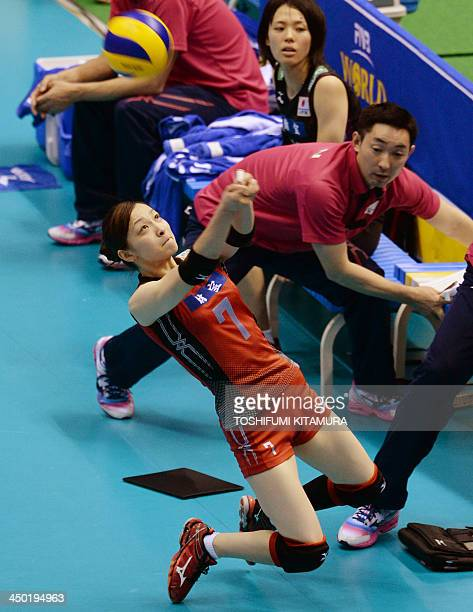 Libero Arisa Sato of Japan receives the ball in front of the team bench during the FIVB volleyball women's Grand Champions Cup match against Brazil...