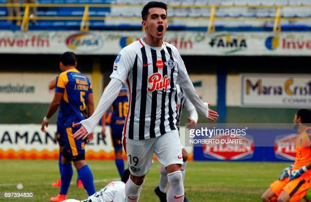 Libertad's footballer Jesus Medina celebrates after scoring against Sportivo Luqueno during their Paraguayan Apertura tournament match at the...
