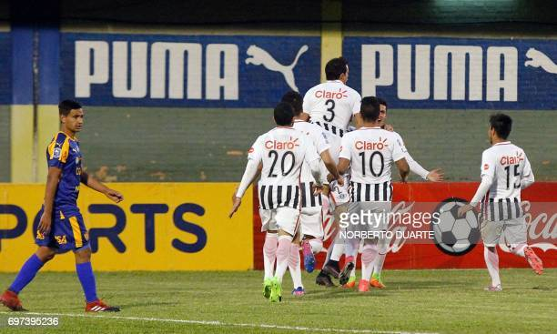 Libertad's footballers celebrate after scoring against Sportivo Luqueno during their Paraguayan Apertura tournament match at the Feliciano Caceres...