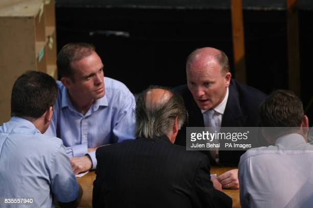 Libertas candidate Declan Ganley and his brother sean sitting with count officials after the results of the first count in the European Parlimentary...