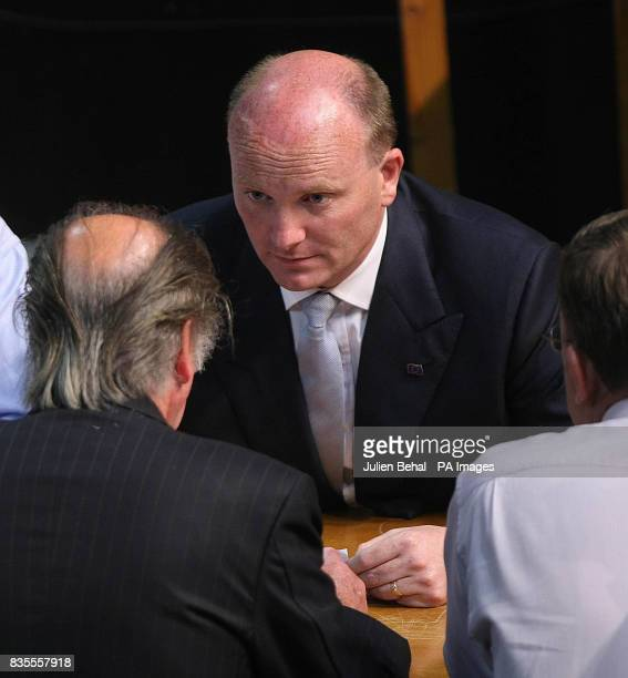 Libertas candidate Declan Ganley sitting with count officials after the results of the first count in the European Parliamentary Elections for the...