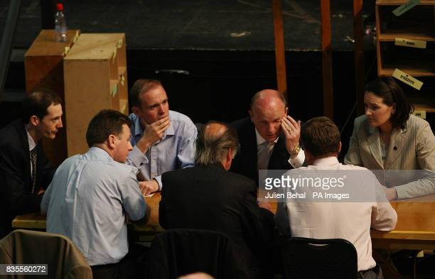 Libertas Candidate Declan Ganley with his brother Sean and Ailish Mulroy Director of Elections sitting with count officials after the results of the...