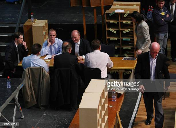 Libertas candidate Declan Ganley with his brother Sean Father Mick and Ailish Mulroy director of elections sitting with count officials after the...