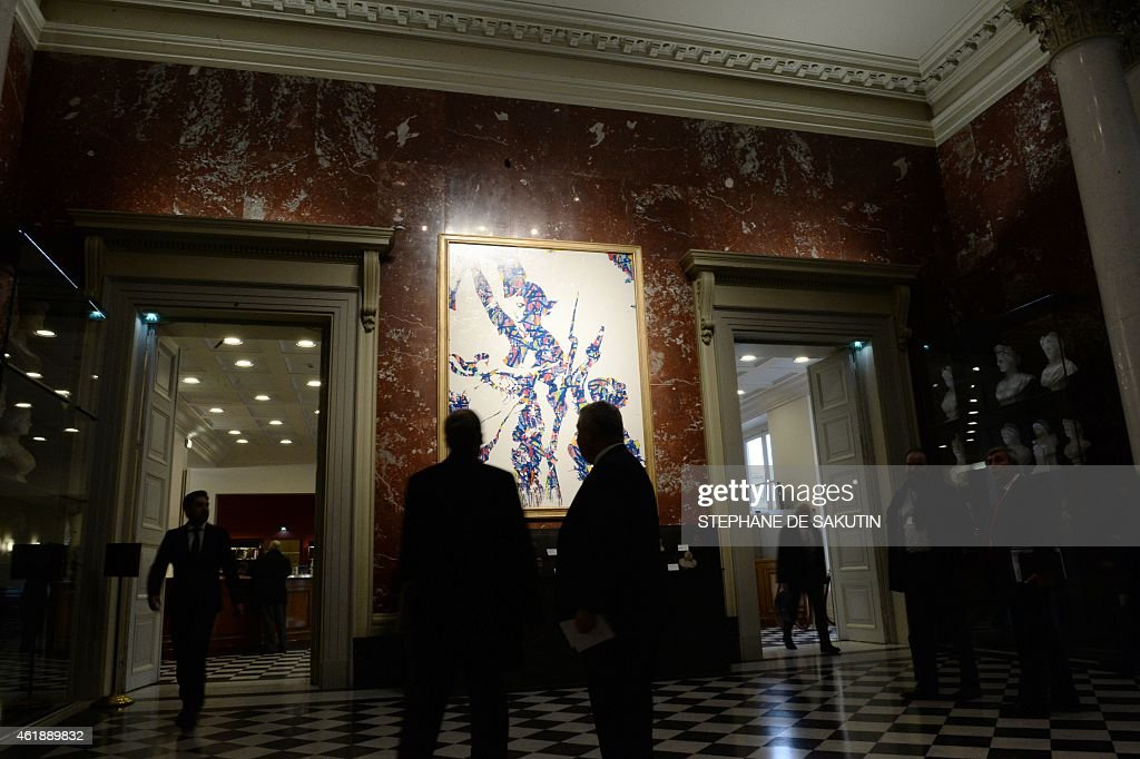 'Liberty Guiding the People' by US graffiti artist JonOne, inspired by a 1830 painting by Eugene Delacroix commemorating the July Revolution, is displayed in the Salon des Mariannes at the French National Assembly in Paris, on January 21, 2015. AFP PHOTO / STEPHANE DE SAKUTIN == RESTRICTED TO EDITORIAL USE, MANDATORY MENTION OF THE ARTIST UPON PUBLICATION, TO ILLUSTRATE THE EVENT AS SPECIFIED IN THE CAPTION ==