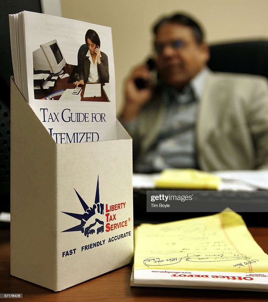 Liberty Tax Service office manager and tax preparer Al Lalani talks on the phone with a client March 24, 2006 in Mount Prospect, Illinois. Americans are preparing for the income tax filing deadline next month whether using tax software, filing on the paper forms or using a tax preparer.
