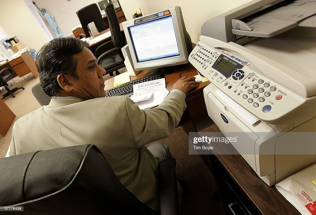 Liberty Tax Service office manager and tax preparer Al Lalani works on a client's tax return March 24, 2006 in Mount Prospect, Illinois. Americans are preparing for the income tax filing deadline next month, whether using tax software, filing on the paper forms or using a tax preparer.