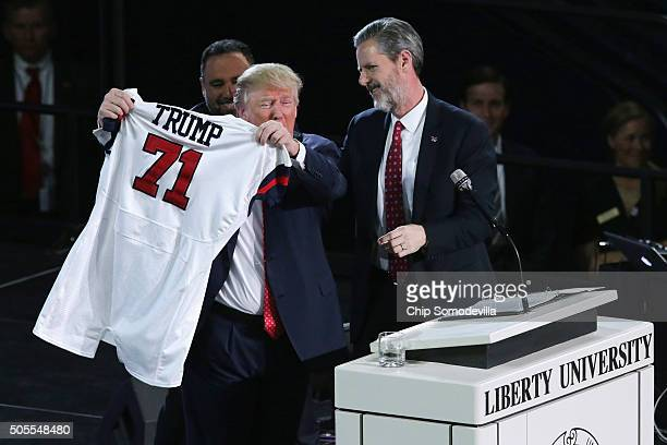 Liberty University President Jerry Falwell Jr presents Republican presidential candidate Donald Trump with a sports jersey after he delivered the...