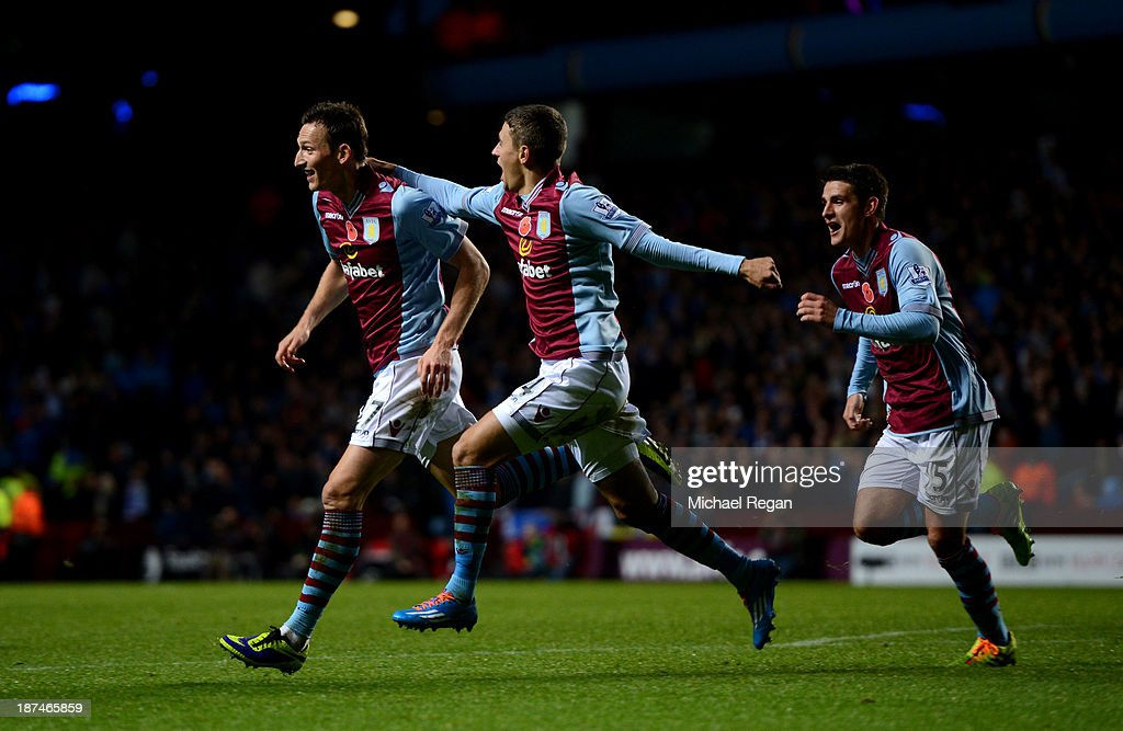 Libor Kozak (L) #27 of Aston Villa celebrates with teammates after scoring his team's second goal past goalkeeper David Marshall of Cardiff during the Barclays Premier League match between Aston Villa and Cardiff City at Villa Park on November 9, 2013 in Birmingham, England.