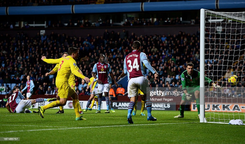 Libor Kozak (L) #27 of Aston Villa scores his team's second goal past goalkeeper <a gi-track='captionPersonalityLinkClicked' href=/galleries/search?phrase=David+Marshall&family=editorial&specificpeople=4668874 ng-click='$event.stopPropagation()'>David Marshall</a> of Cardiff during the Barclays Premier League match between Aston Villa and Cardiff City at Villa Park on November 9, 2013 in Birmingham, England.