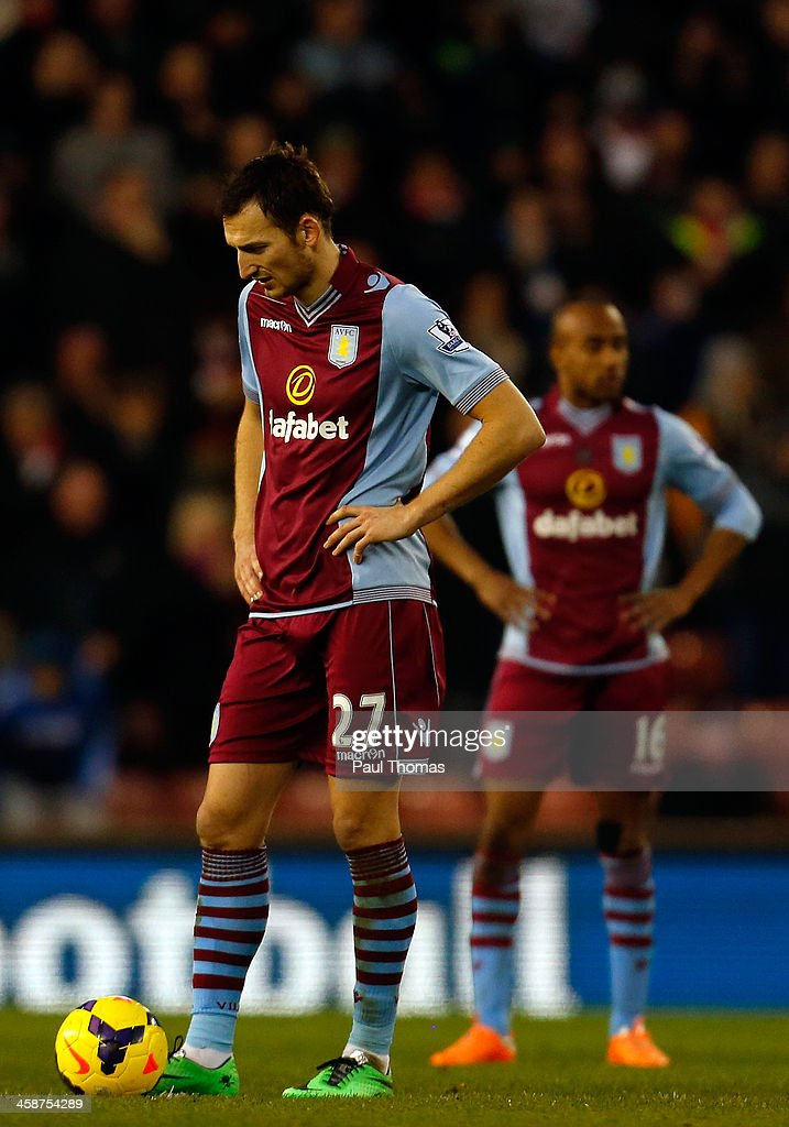 Libor Kozak (L) and <a gi-track='captionPersonalityLinkClicked' href=/galleries/search?phrase=Fabian+Delph&family=editorial&specificpeople=5443479 ng-click='$event.stopPropagation()'>Fabian Delph</a> of Aston Villa react after Stoke score their second goal during the Barclays Premier League match between Stoke City and Aston Villa at the Britannia Stadium on December 21, 2013 in Stoke-on-Trent, England.