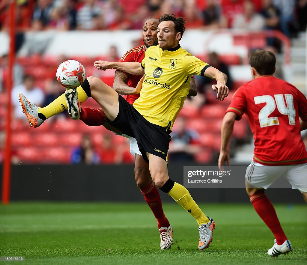 Libor Kozak of Aston Villa battles with Kelvin Wilson of Nottingham Forest during the Pre Season Friendly match between Nottingham Forest and Aston Villa at City Ground on August 1, 2015 in Nottingham, England.