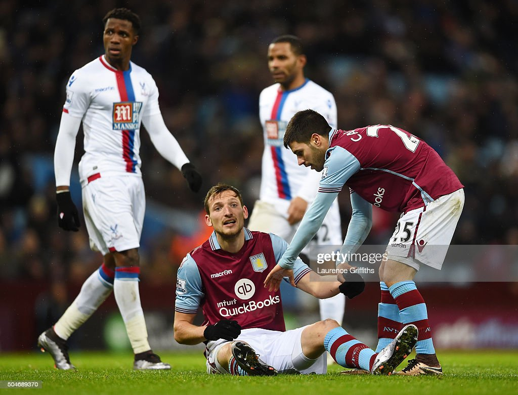 Libor Kozak of Aston Villa is assisted by team mate <a gi-track='captionPersonalityLinkClicked' href=/galleries/search?phrase=Carles+Gil&family=editorial&specificpeople=9437163 ng-click='$event.stopPropagation()'>Carles Gil</a> during the Barclays Premier League match between Aston Villa and Crystal Palace at Villa Park on January 12, 2016 in Birmingham, England.