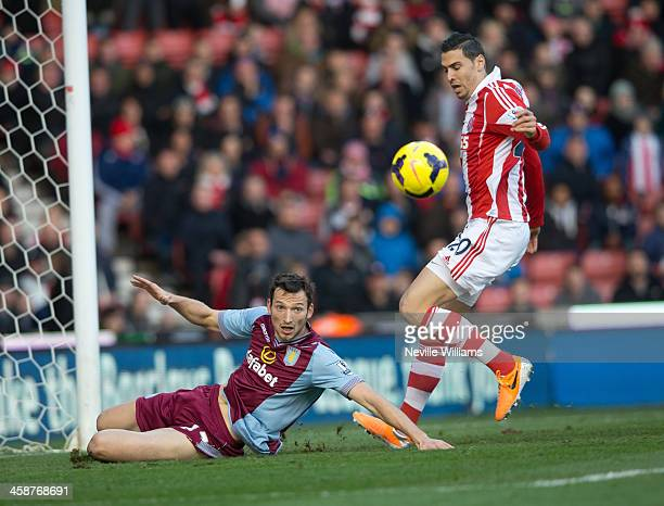 Libor Kozak of Aston Villa is challenged by Geoff Cameron of Stoke City during the Barclays Premier League match between Stoke City and Aston Villa...