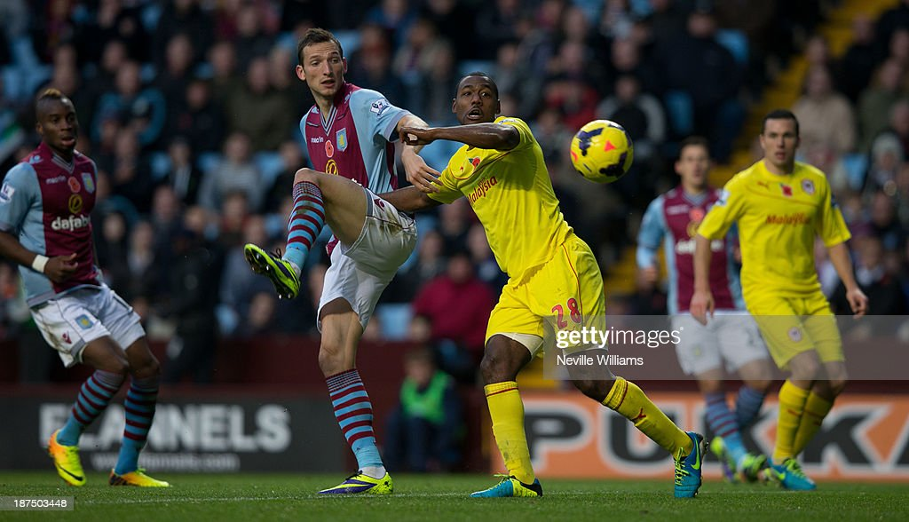 Libor Kozak of Aston Villa is challenged by Kevin Theophile-Catherine of Cardiff City during the Barclays Premier League match between Aston Villa and Cardiff City at Villa Park on November 09, 2013 in Birmingham, England.