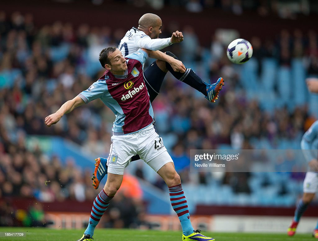 Libor Kozak of Aston Villa is challenged by Sandro of Tottenham Hotspur during the Barclays Premier League match between Aston Villa and Tottenham Hotspur at Villa Park on October 20, 2013 in Birmingham, England.