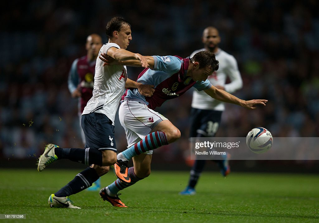 Libor Kozak of Aston Villa is challenged by Vlad Chiriches of Tottenham Hotspur during the Capital One Cup Third Round match between Aston Villa and Tottenham Hotspur at Villa Park on September 24, 2013 in Birmingham, England.
