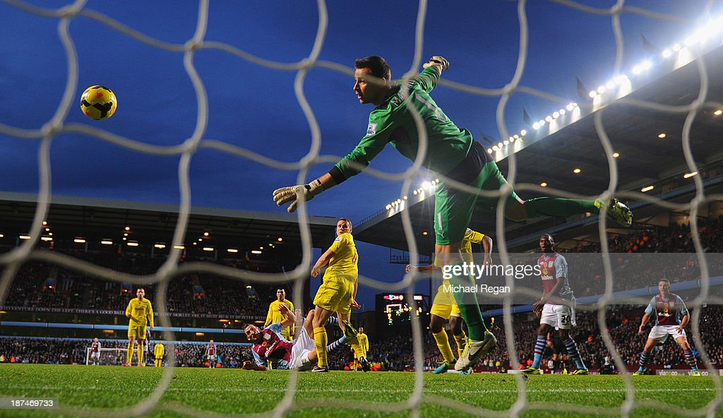 Libor Kozak of Aston Villa scores his team's second goal past goalkeeper <a gi-track='captionPersonalityLinkClicked' href=/galleries/search?phrase=David+Marshall&family=editorial&specificpeople=4668874 ng-click='$event.stopPropagation()'>David Marshall</a> of Cardiff during the Barclays Premier League match between Aston Villa and Cardiff City at Villa Park on November 9, 2013 in Birmingham, England.