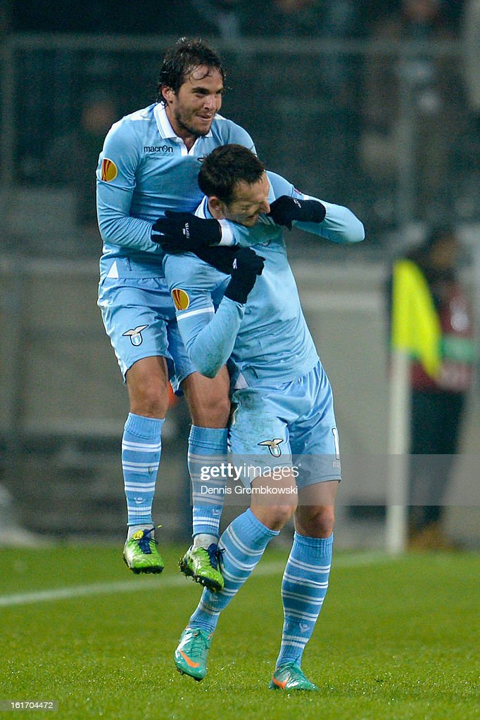 Libor Kozak of Lazio celebrates with teammate Alvaro Gonzalez after scoring his team's second goal during the UEFA Europa League round of 32 first leg match between VfL Borussia Moenchengladbach and S.S. Lazio at Borussia Park Stadium on February 14, 2013 in Moenchengladbach, Germany.