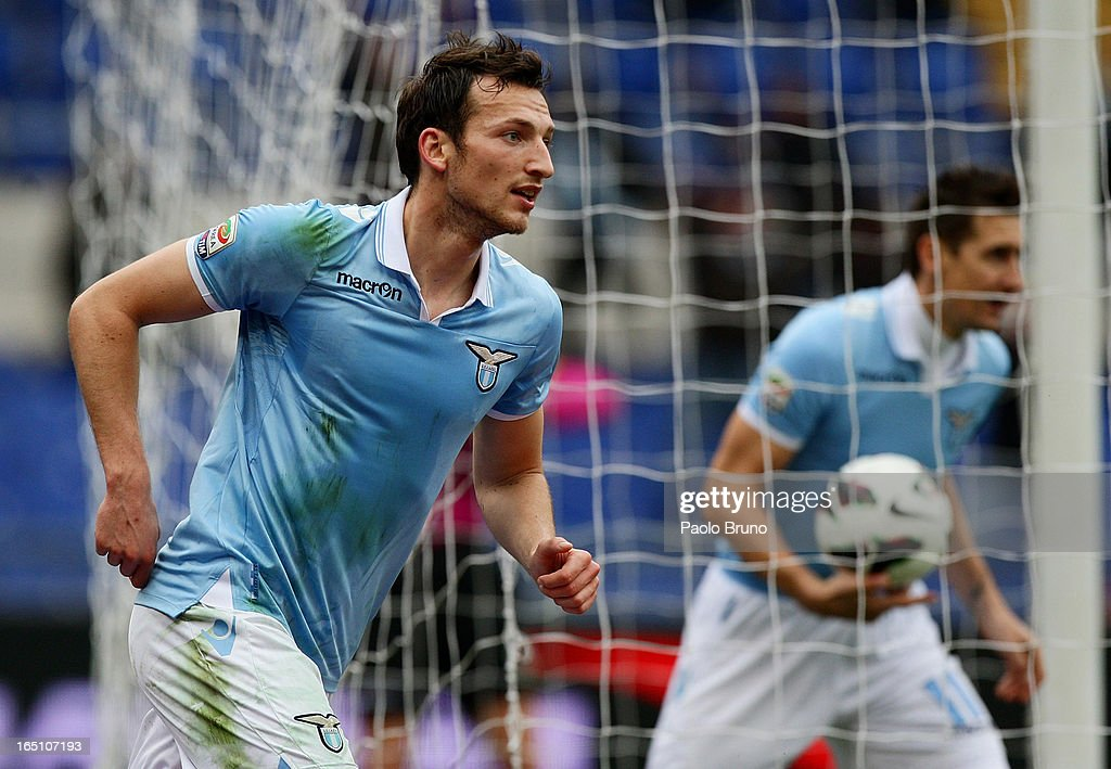 Libor Kozak (L) of S.S. Lazio celebrates after scoring his team's first goal during the Serie A match between S.S. Lazio and Calcio Catania at Stadio Olimpico on March 30, 2013 in Rome, Italy.