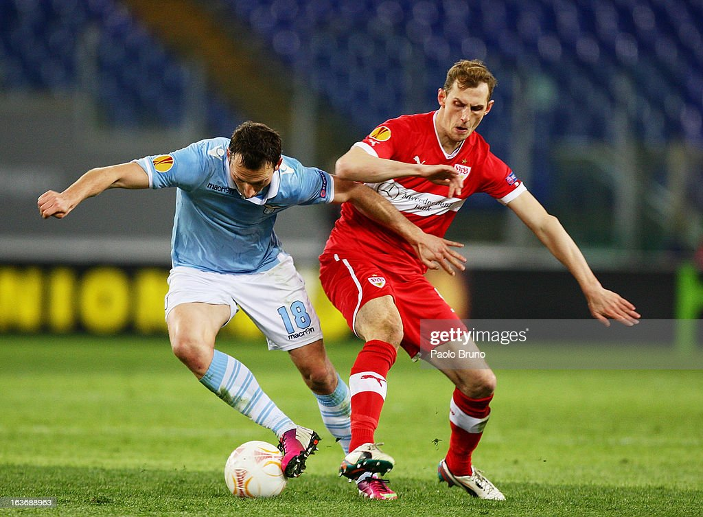 Libor Kozak(L) of S.S. Lazio competes for the ball with Georg Niedermeier of VfB Stuttgart during the UEFA Europa League Round of 16 second leg match between S.S. Lazio and VfB Stuttgart at Stadio Olimpico on March 14, 2013 in Rome, Italy.
