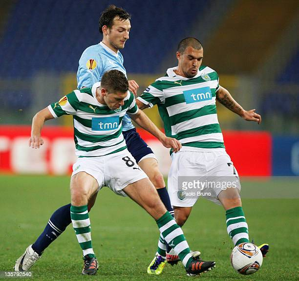 Libor Kozak of SS Lazio competes for the ball with Stijn Schaars and Valeri Bojinov of Sporting Clube de Portugal during the UEFA Europa League group...
