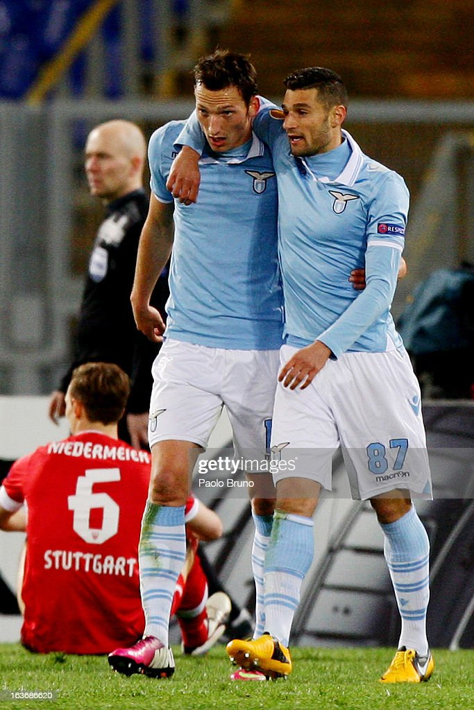 Libor Kozak (L) with his teammate Antonio Candreva of S.S. Lazio celebrates after scoring the second team's goal during the UEFA Europa League Round of 16 second leg match between S.S. Lazio and VfB Stuttgart at Stadio Olimpico on March 14, 2013 in Rome, Italy.