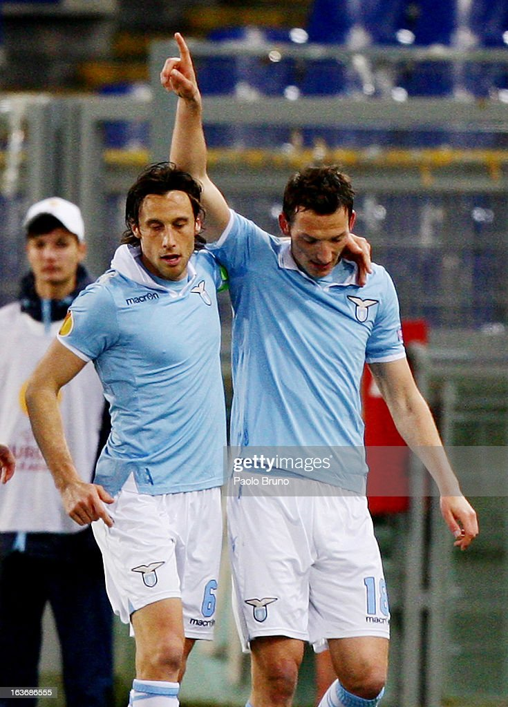 Libor Kozak #18 with his teammate Stefano Mauri of S.S. Lazio celebrates after scoring the opening goal during the UEFA Europa League Round of 16 second leg match between S.S. Lazio and VfB Stuttgart at Stadio Olimpico on March 14, 2013 in Rome, Italy.