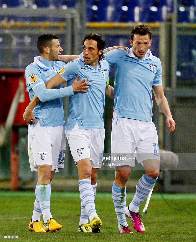 Libor Kozak (R) with his teammates Stefano Mauri (C) and Antonio Candreva of S.S. Lazio celebrates after scoring the opening goal during the UEFA Europa League Round of 16 second leg match between S.S. Lazio and VfB Stuttgart at Stadio Olimpico on March 14, 2013 in Rome, Italy.
