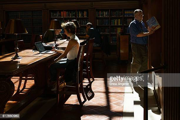 A librarian puts backs on the shelves in the Bill Blass Public Catalog Room adjacent to the Rose Main Reading Room at the New York Public Library...