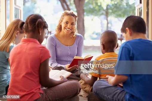 Librarian reads aloud to a group of children