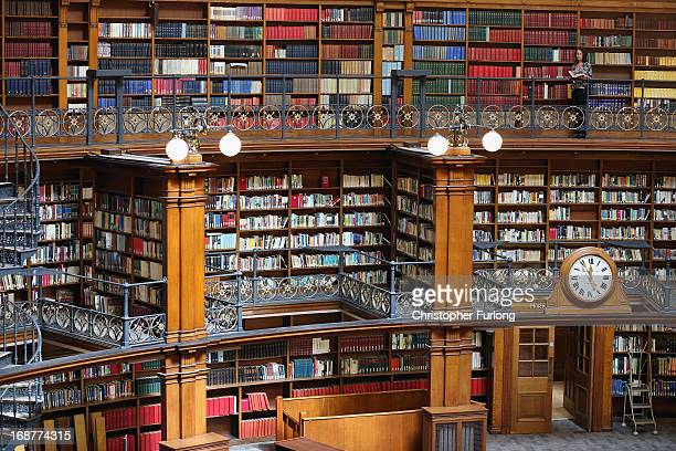 Librarian Ruth Grodner finishes the task of restocking books in the restored Picton Reading Room in Liverpool Central Library on May 15 2013 in...