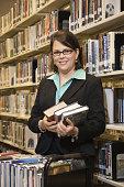 Librarian shelving books