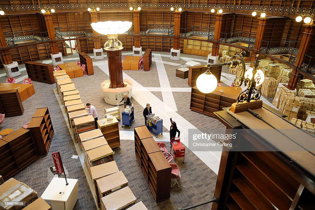 Librarians begin the task of restocking books in the restored Picton Reading Room in Liverpool Central Library on January 23, 2013 in Liverpool, England. After ten years of planning and over two years of restoration, Liverpool's Central Library is near completion for it's official opening in May. Over four millions items, including documents and books, are now to be rehoused in the library which has cost GBP 55 million.