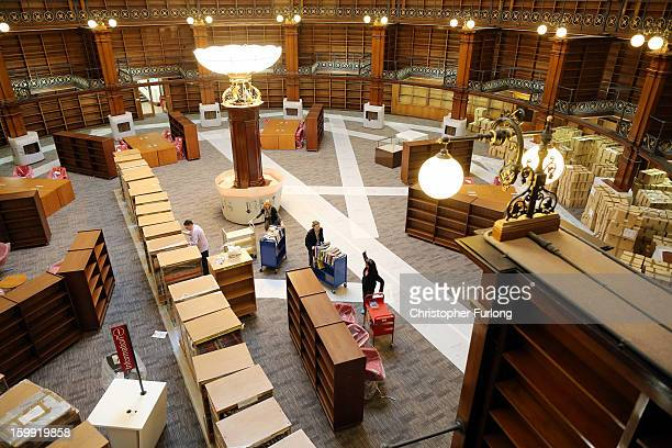 Librarians begin the task of restocking books in the restored Picton Reading Room in Liverpool Central Library on January 23 2013 in Liverpool...