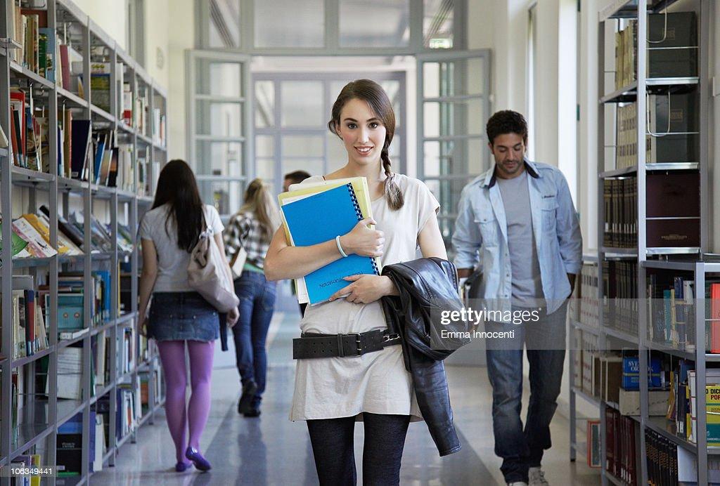 library, corridor, plated hair, portrait, books : Stock Photo