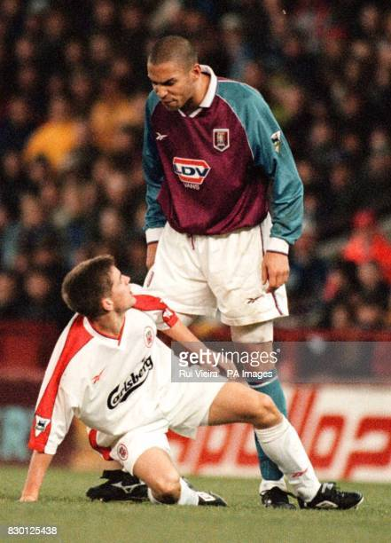 Library file dated 21/11/98 Aston Villa's Stan Collymore stands over Liverpool's felled Michael Owen after a foul which earned Collymore a second...