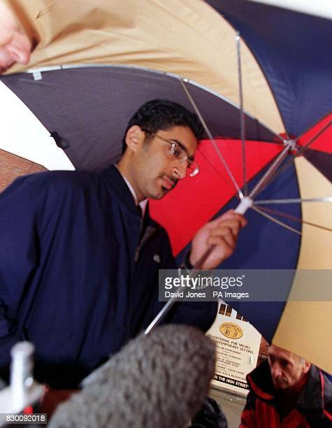 Library filer dated 1/10/98 of Satvinder Nijjer using an umbrella to evade waiting TV crews as he arrives at Stafford Crown Court where he is accused...