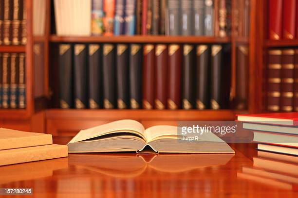 Library Open Book Laying on a Desk in a Study