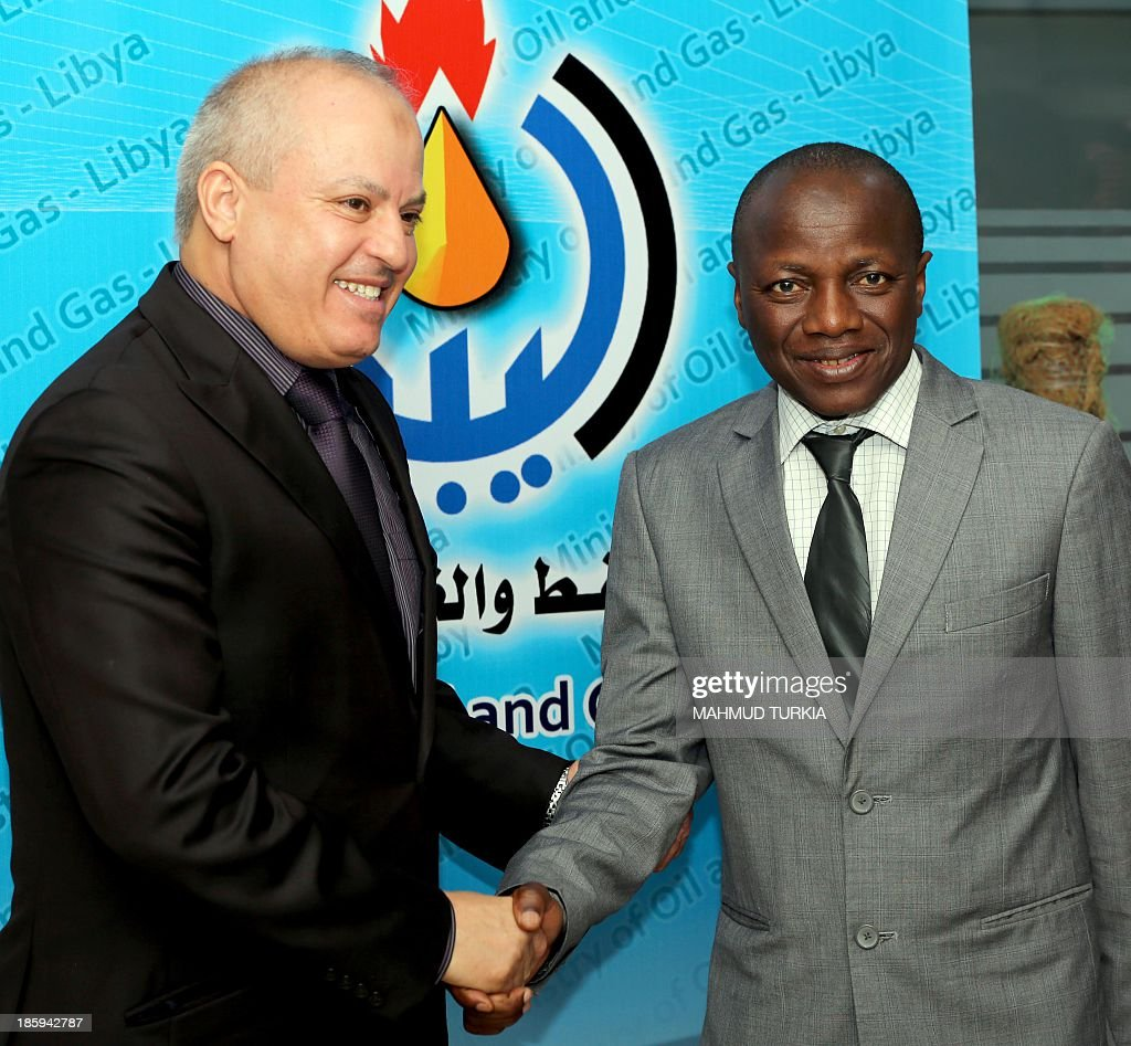 Libya Oil and Gas minister Abdulbari Al Arusi (L) shakes hands with South African minister in the presidency Collins Chabane(R) at the end of their meeting on October 26, 2013 in Tripoli.